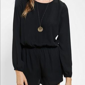 Lucca couture open back black romper